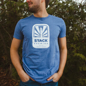 Man with hands in pockets wearing Stack t-shirt