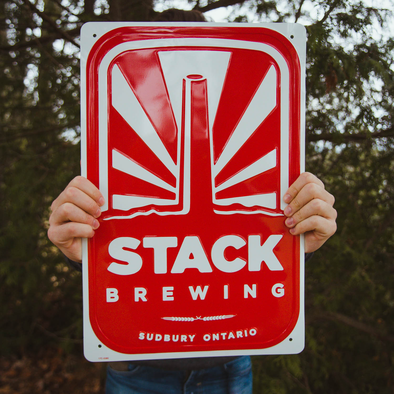 Hands holding Stack tin tacker