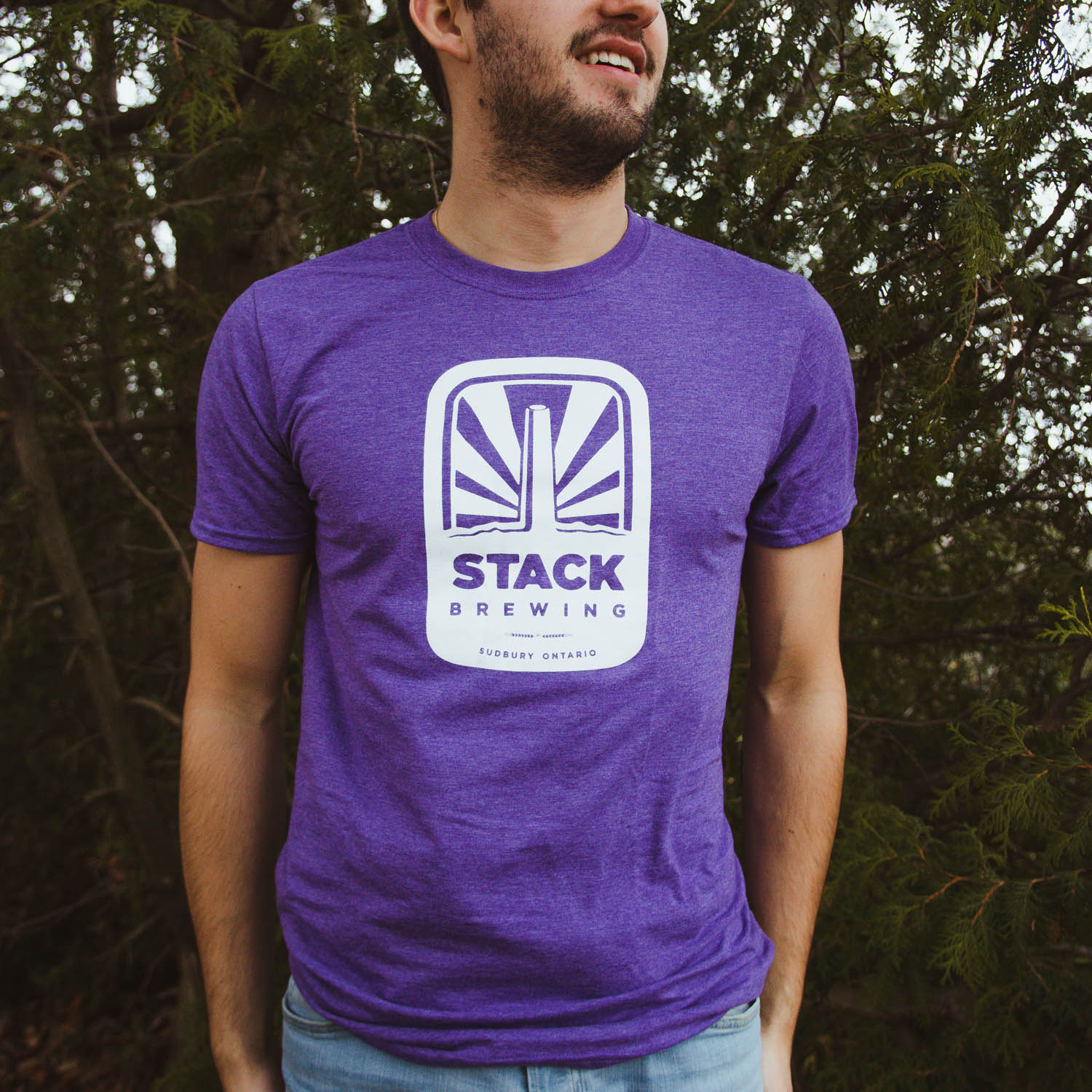 Man wearing purple Stack t-shirt