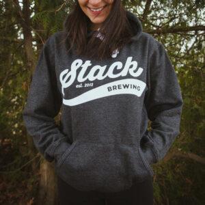 Woman wearing Stack Varsity logo hoodies